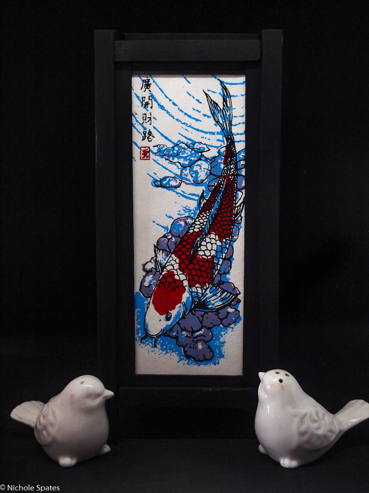 simple table top still life, asian koi fish lantern, two ceramic birds