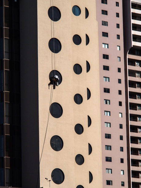 Window washer at work in Honolulu, orginal photography