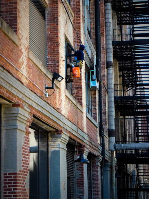 Unsung Hero Brooklyn, window washer at work, art photography, lensmomentsns art for sale by artist, urban