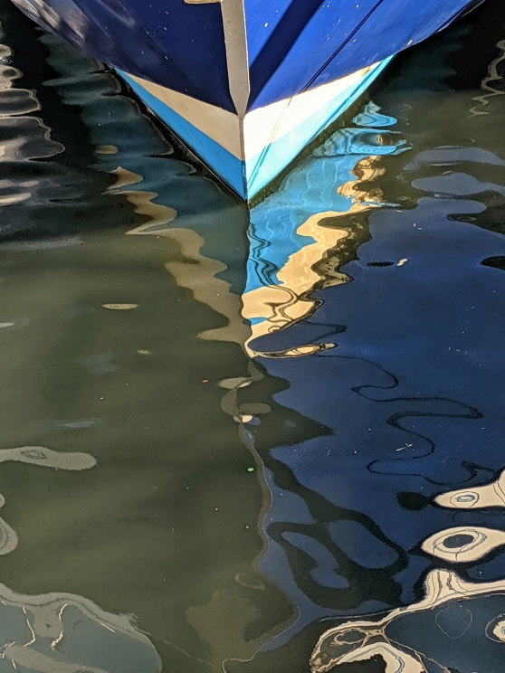 Blue Harbor, a photo by LensMoments by Nichole Spates (c) 2019 blue boat hull reflected in water