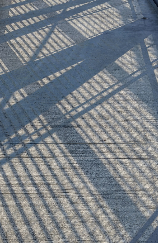 a composite photo of shadows cast by the architecture of a bridge - shadow wars- (c) 2021 LensMoments - Nichole Spates